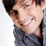 stock-photo-11452067-face-of-a-happy-handsome-young-guy
