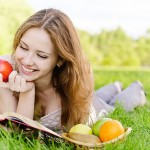 stock-photo-14848798-girl-with-book-and-apples